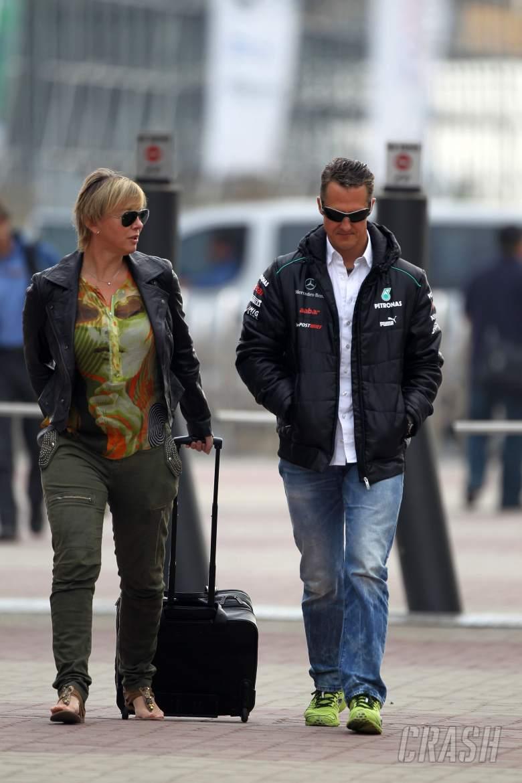 13.10.2012- Sabine Kehm (GER), Michael Schumacher's press officer and Michael Schumacher (GER) Merc