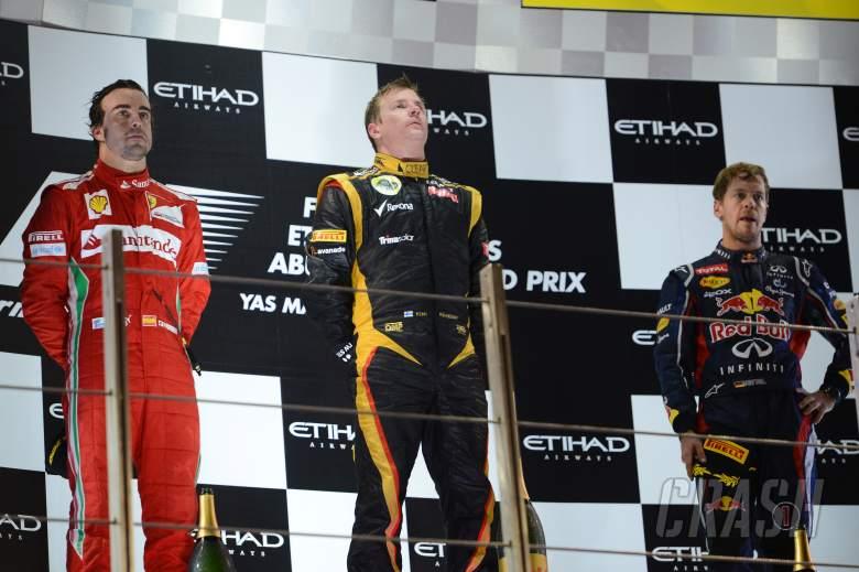 Podium: Kimi Raikkonen (FIN) Lotus F1 Team E20 (race winner), Fernando Alonso (ESP) Scuderia Ferrari
