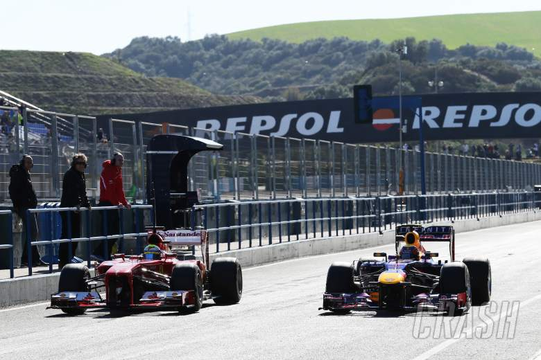,  - (L to R): Felipe Massa (BRA) Ferrari F138 and Mark Webber (AUS) Red Bull Racing RB9 in the pits.06.