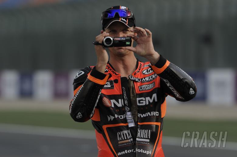 Edwards, filming on his camcorder, Qatar MotoGP 2013