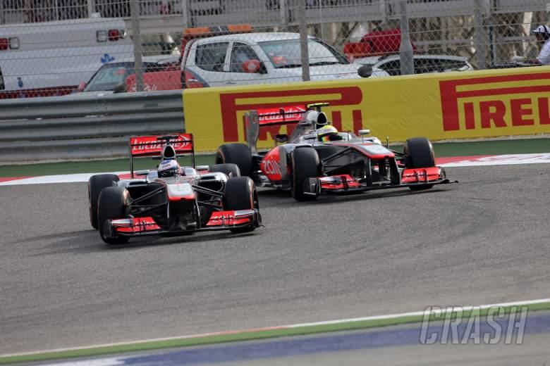 21.04.2013- Race, Jenson Button (GBR) McLaren Mercedes MP4-28 and Sergio Perez (MEX) McLaren MP4-28