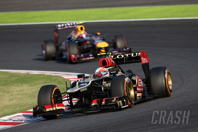 13.10.2013- Race, Romain Grosjean (FRA) Lotus F1 Team E21 leads Mark Webber (AUS) Red Bull Racing RB
