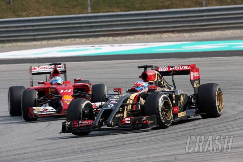 : 30.03.2014 - Race, Fernando Alonso (ESP) Scuderia Ferrari F14-T and Romain Grosjean (FRA) Lotus F1 T