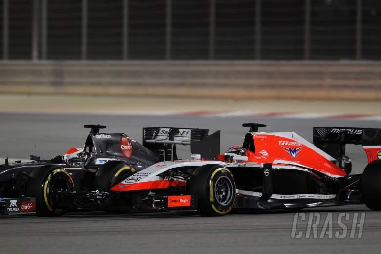 06.04.2014- Race, Adrian Sutil (GER) Sauber F1 Team C33 and Jules Bianchi (FRA) Marussia F1 Team MR0