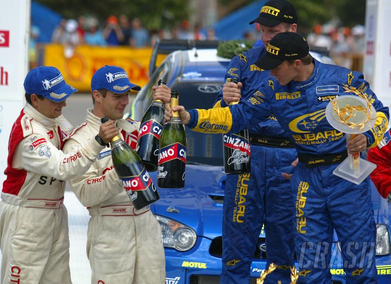, , Acropolis Rally winners Petter Solberg and Phil Mills on the podium with Sebastian Loeb and Daniel E