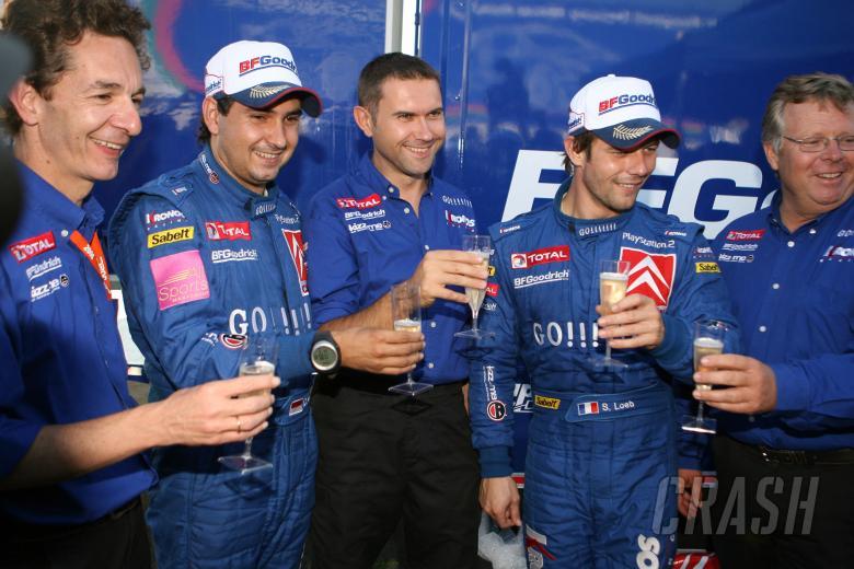 , , Sebastien Loeb and Daniel Elena celebrate their Cyprus win with Kronos boss, Marc van Dalen and co W
