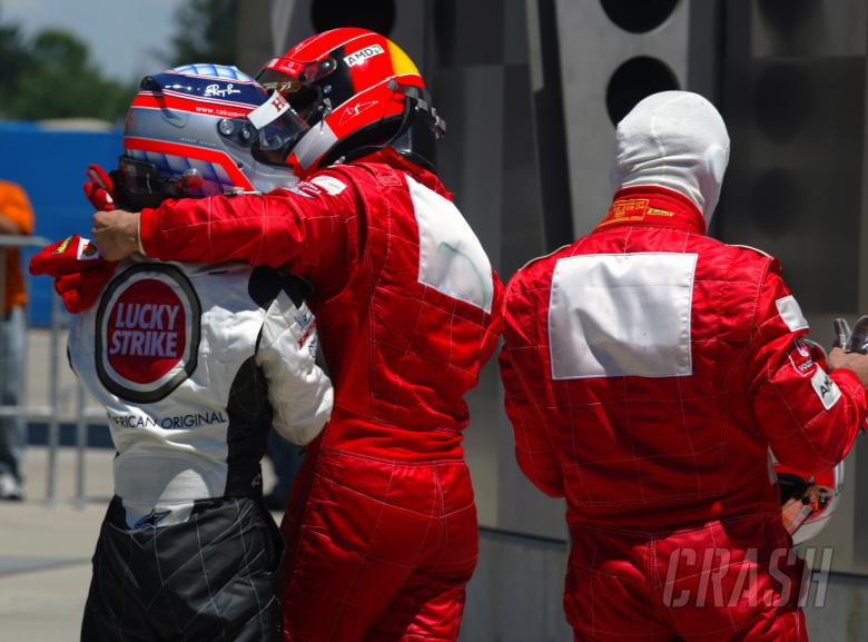 Michael Schumacher congratulates Takuma Sato