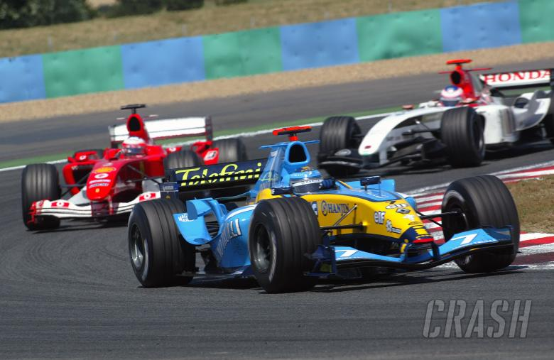 Jarno Trulli, Rubens Barrichello and Jenson Button battle during the French Grand Prix