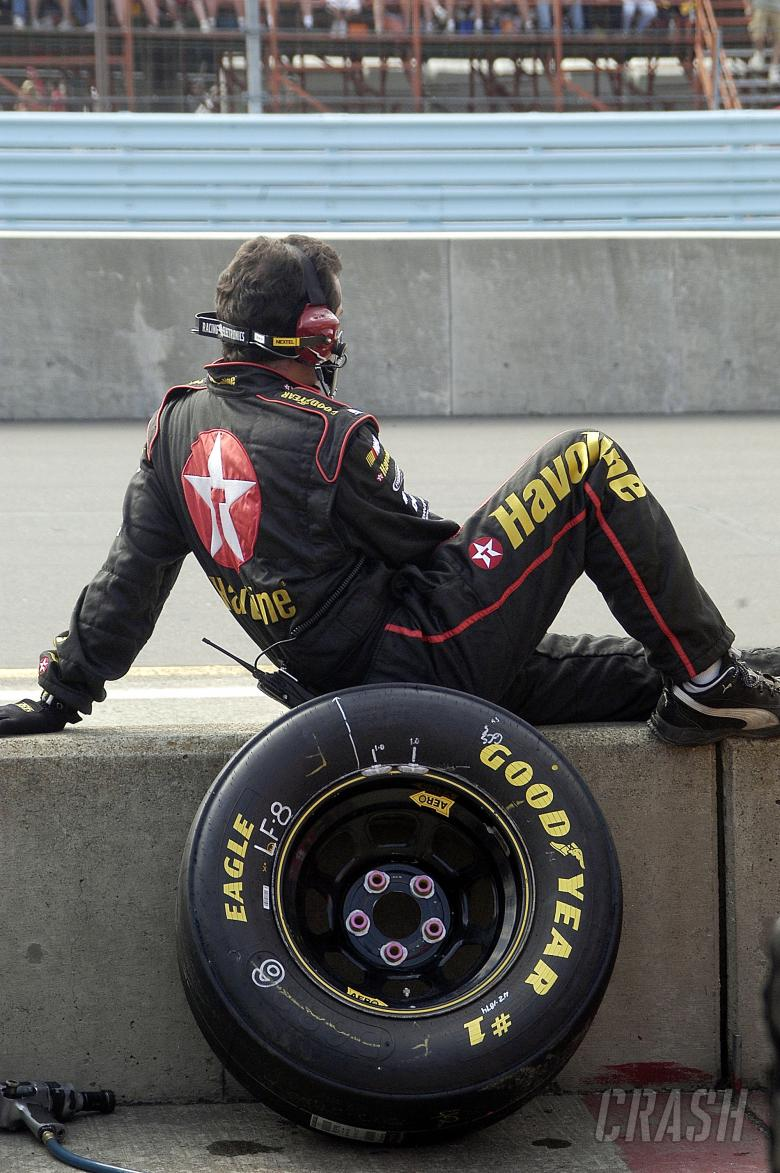 One of Jamie McMurray`s crew members waits on pit road at Watkins Glen.