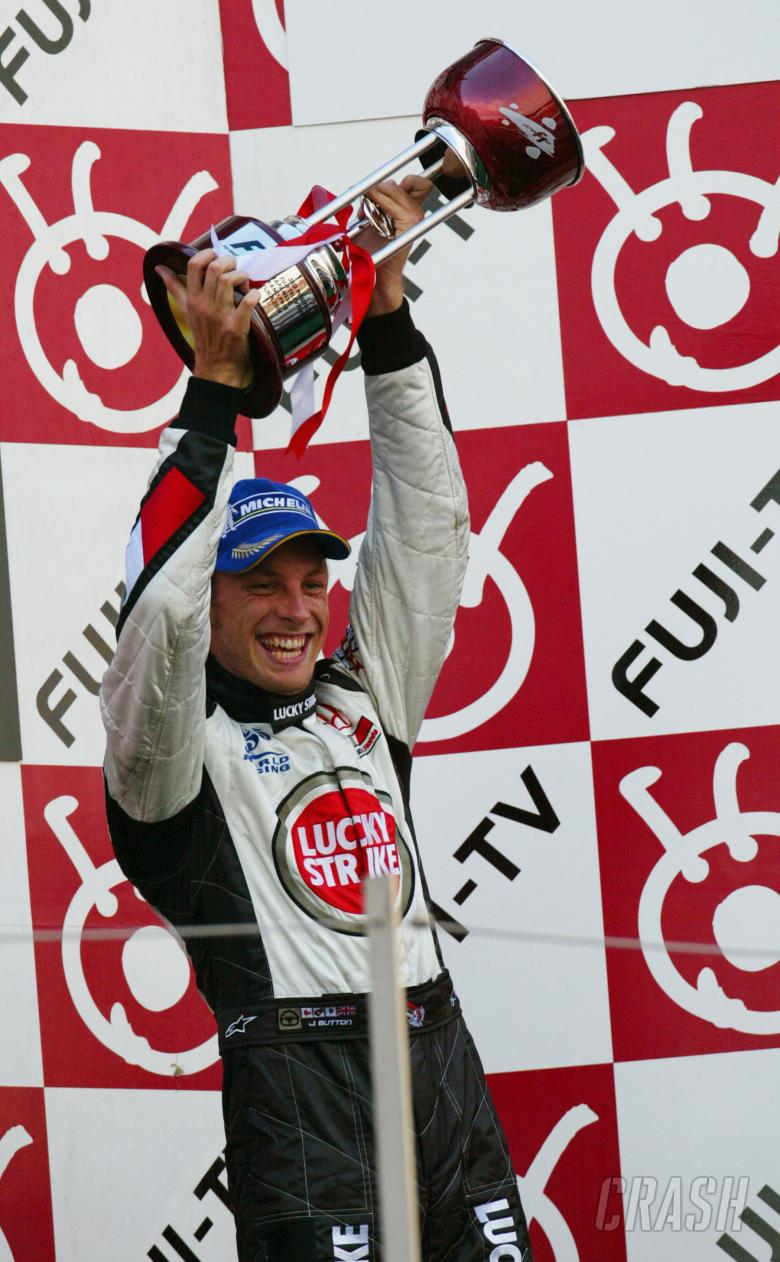 , , Jenson Button celebrates his tenth podium of the year, after taking third place at the 2004 Japanese