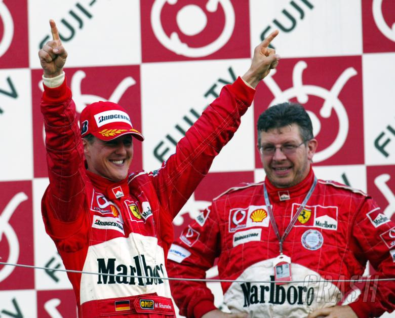 Michael Schumacher and Ross Brawn celebrate another perfect race at the 2004 Japanese Grand Prix