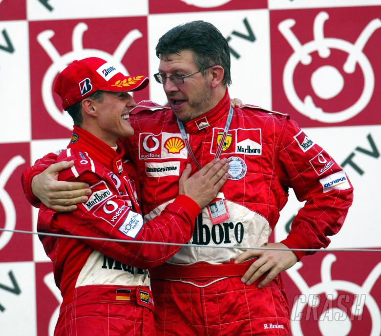 Michael Schumacher and Ross Brawn celebrate another perfect race at the Japanese Grand Prix