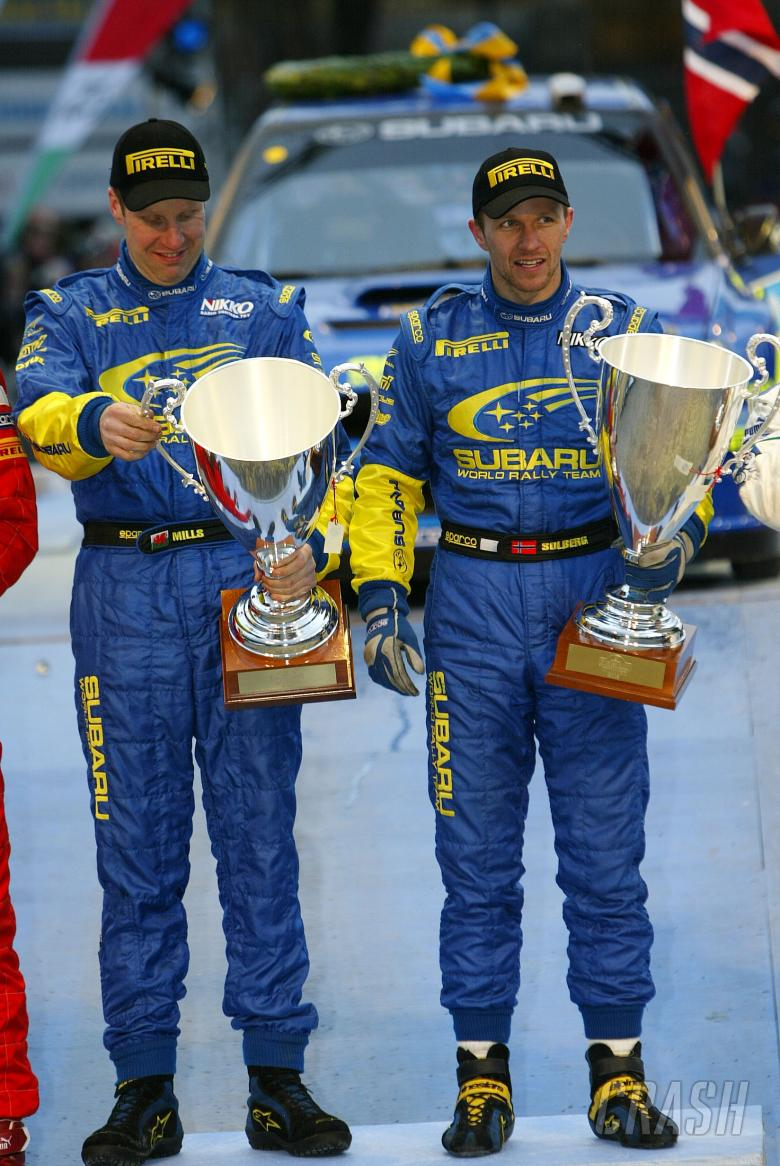 Subaru`s Petter Solberg and Phil Mills celebrate their victory on the Swedish Rally