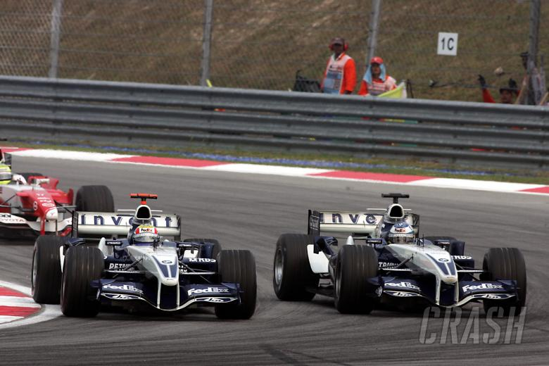 , , Nick Heidfeld dices with Williams team-mate Mark Webber in Malaysia