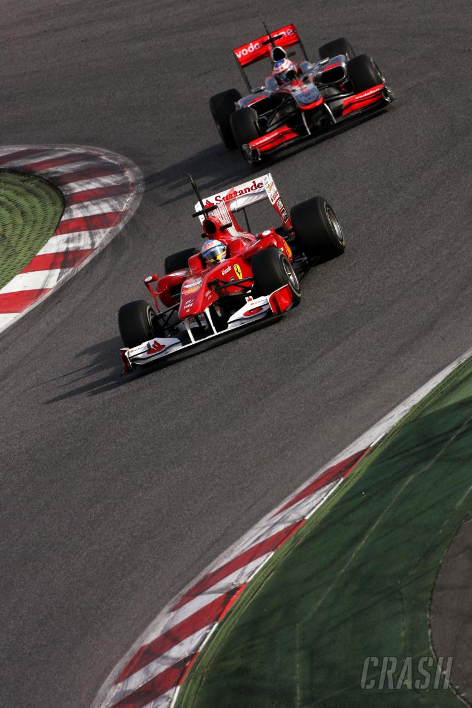 25.02.2010 Barcelona, Spain, Fernando Alonso (ESP), Scuderia Ferrari and Jenson Button (GBR), McLare