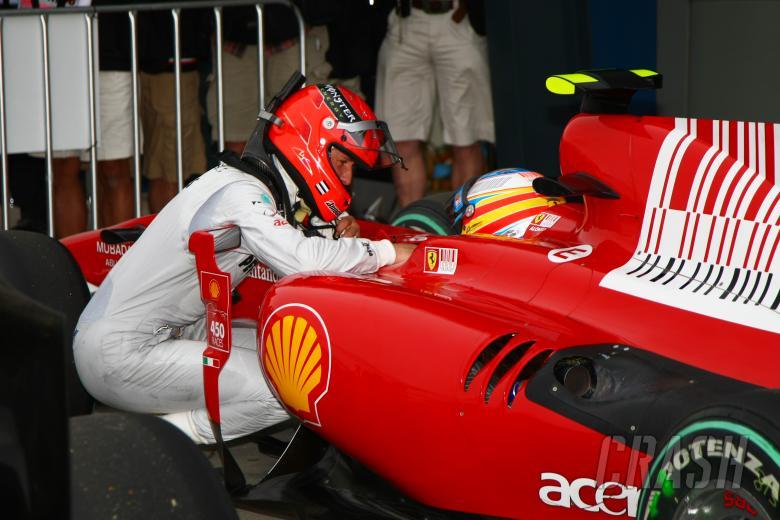 Fernando Alonso (ESP) Scuderia Ferrari F10 & Michael Schumacher, Mercedes GP MGP W01
