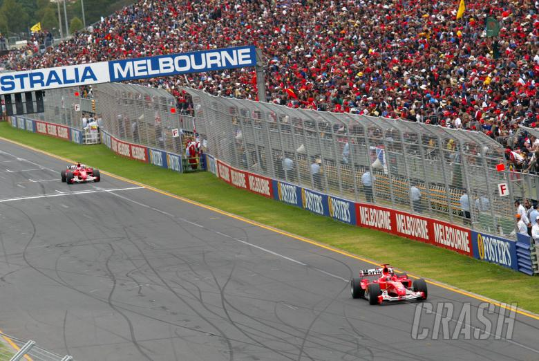 Michael Schumacher leads Rubens Barrichello at the end of the first lap of the 2004 Australian Grand
