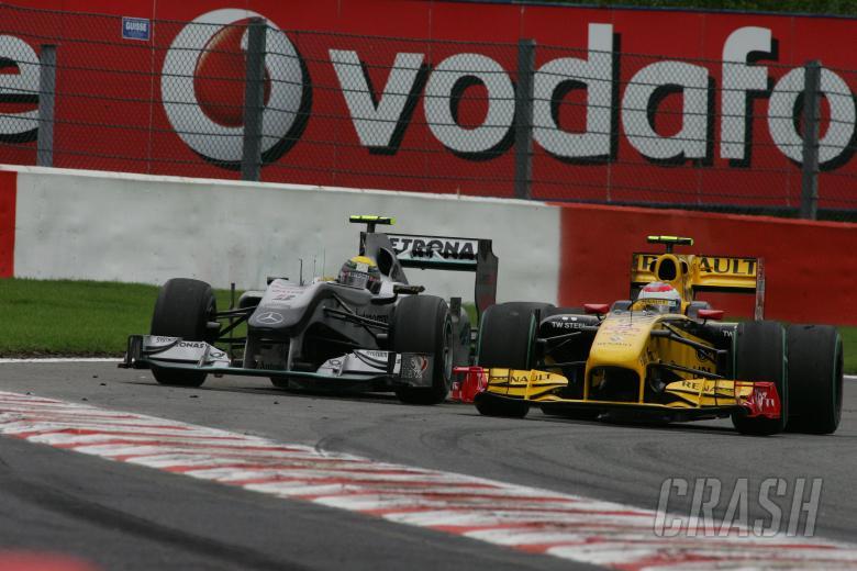 Race, Nico Rosberg (GER), Mercedes GP F1 Team, MGP W01 and Vitaly Petrov (RUS), Renault F1 Team, R30
