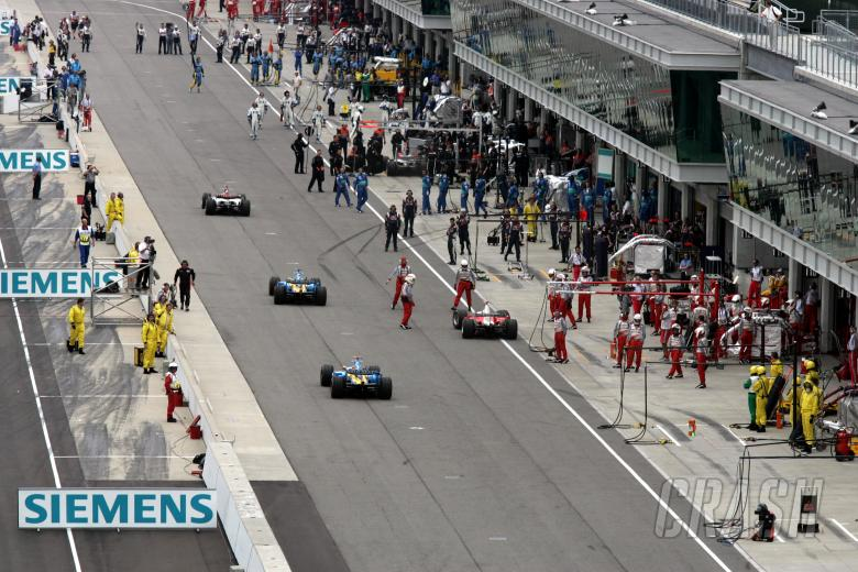, , The Michelin teams pull back into their pit garages at the start of the United States Grand Prix