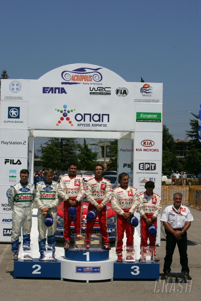 Acropolis Rally winners, Sebastien Loeb and Daniel Elena on the podium  with Toni Gardemeister and J