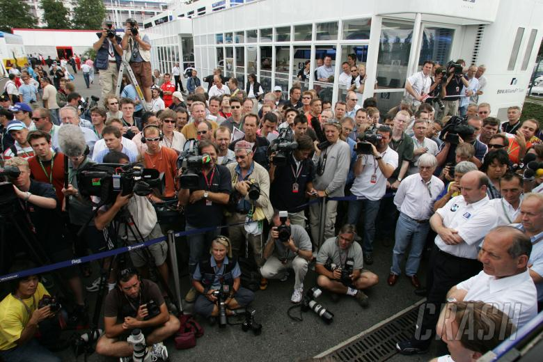 The Michelin team bosses and Bernie Ecclestone hold a press conference outside Michelin`s motorhome