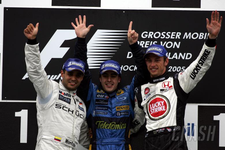 Race winner Fernando Alonso, Juan Pablo Montoya and Jenson Button on the German Grand Prix podium