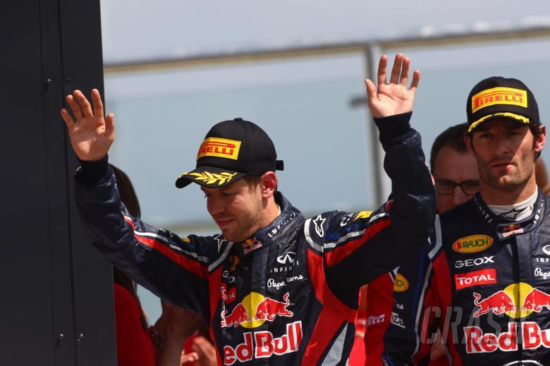 10.07.2011- Race, Sebastian Vettel (GER), Red Bull Racing, RB7 2nd position and Mark Webber (AUS), R