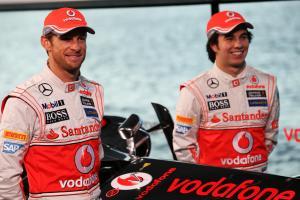 (L to R): Jenson Button (GBR) McLaren with team mate Sergio Perez (MEX) McLaren.31.01.2013. McLaren