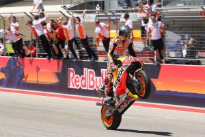 Famous five for Marquez, Rossi title lead