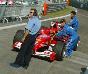 Michael Schumacher returns to the pits after spinning in qualifying for the 2004 Chinese Grand Prix