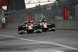 12.06.2011- Race, Vitantonio Liuzzi (ITA), Hispania Racing F1 Team, HRT  and Narain Karthikeyan (IND