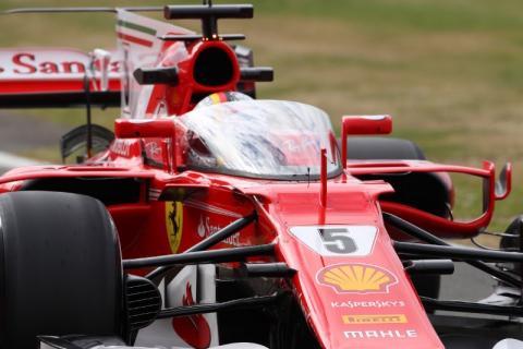 Sebastian Vettel and the Shield on his Ferrari SF70H