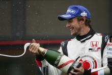 BAR`s Jenson Button celebrates third place in the Belgian Grand Prix