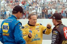 Kenny Schrader explains his driving style to Jamie McMurray and Michael Waltrip at New Hampshire
