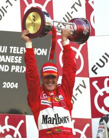 Michael Schumacher picks up another trophy for winning the 2004 Japanese Grand Prix