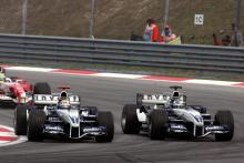 Nick Heidfeld dices with Williams team-mate Mark Webber in Malaysia