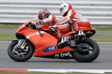 Martin Brundle on the back of Randy Mamola, British MotoGP 2010