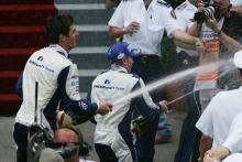 Williams-BMW duo, Mark Webber and Nick Heidfeld celebrate with their team
