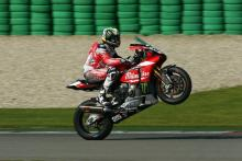 Brookes blasts clear of rivals with lap record pace