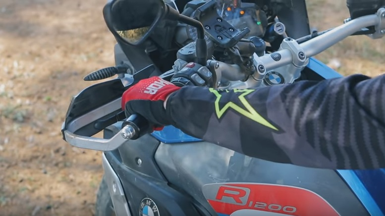 Motorcycle rider holding brake