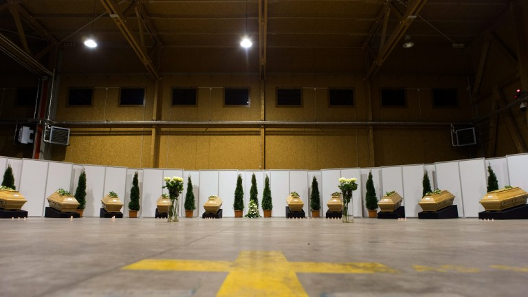 Coffins with the remains of victims of Tuesday's explosion in the historic Sultanahmet district in Istanbul are laid out in a hangar of Berlin Tegel Airport, Germany, Saturday, Jan. 16, 2016. The suicide bomber set off the explosion near the group of German tourists just steps away from the landmark Blue Mosque, killing 10 of them. Authorities said the victims ranged in age from 51 to 73. Photo: Axel Schmidt/dpa +++(c) dpa - Bildfunk+++ (Foto: dpa)