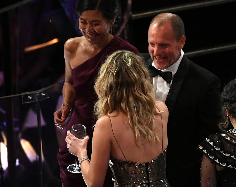 Jennifer Lawrence drinking wine at the Oscars