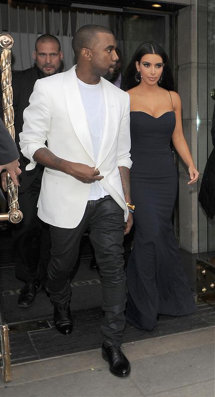 Kanye West and Kim Kardashian leaving their hotel