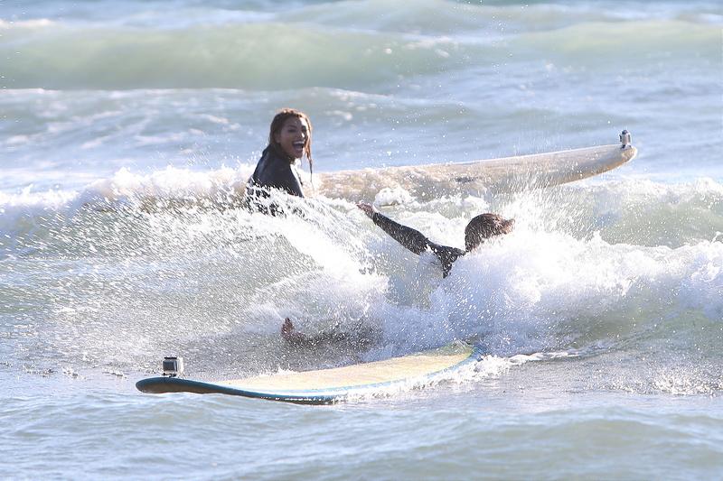 The Saturdays go surfing in LA