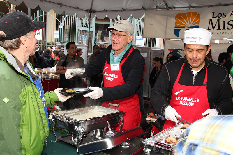 Celebrities help out at Los Angeles Mission Christmas Eve For The Homeless