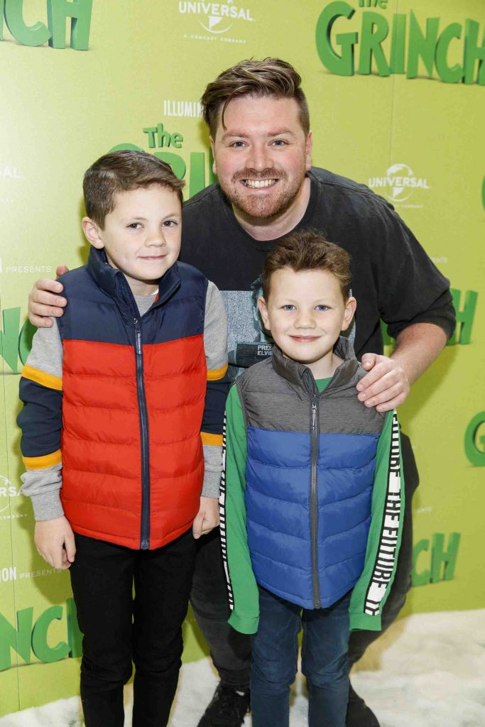 Thomas Cross with Sean (8) and Adam Lumley (6) pictured at the Irish premiere screening of The Grinch at ODEON Point Village, Dublin. Picture Andres Poveda
