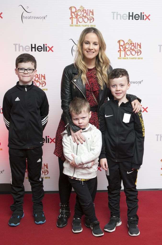 Pictured  Michelle Tighe with Conor , Oisin and Dlyan  at the opening night of The Helix Pantomime, Robin Hood on Saturday night.  Photo: Leon Farrell/Photocall Ireland.