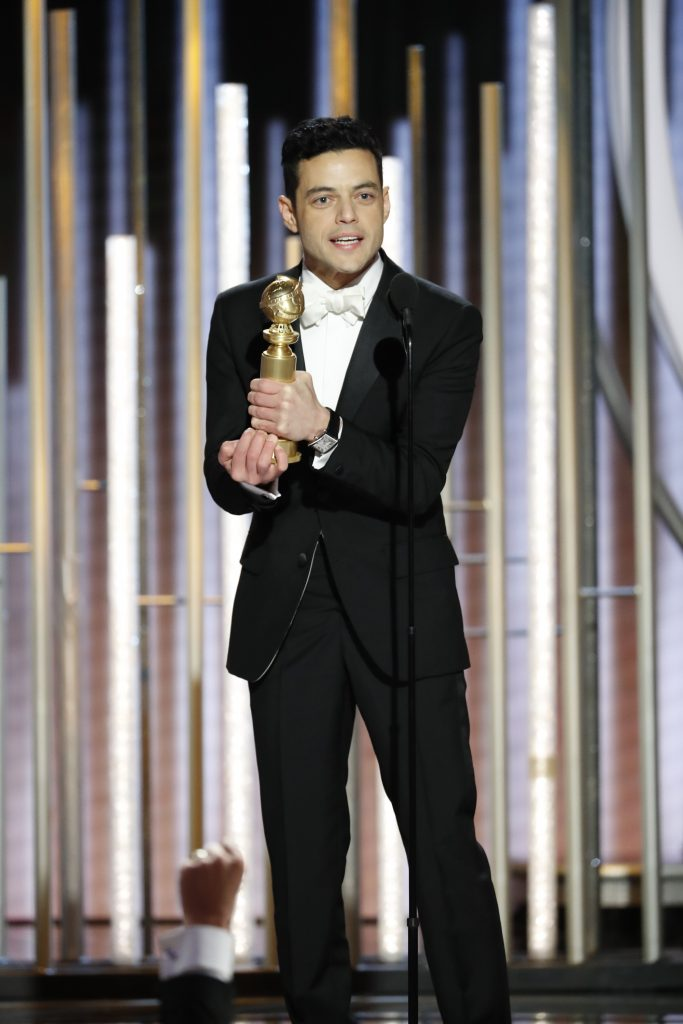 "Rami Malek from ""Bohemian Rhapsody"" accepts the Best Actor in a Motion Picture – Drama award onstage during the 76th Annual Golden Globe Awards at The Beverly Hilton Hotel on January 06, 2019 in Beverly Hills, California.  (Photo by Paul Drinkwater/NBCUniversal via Getty Images)"