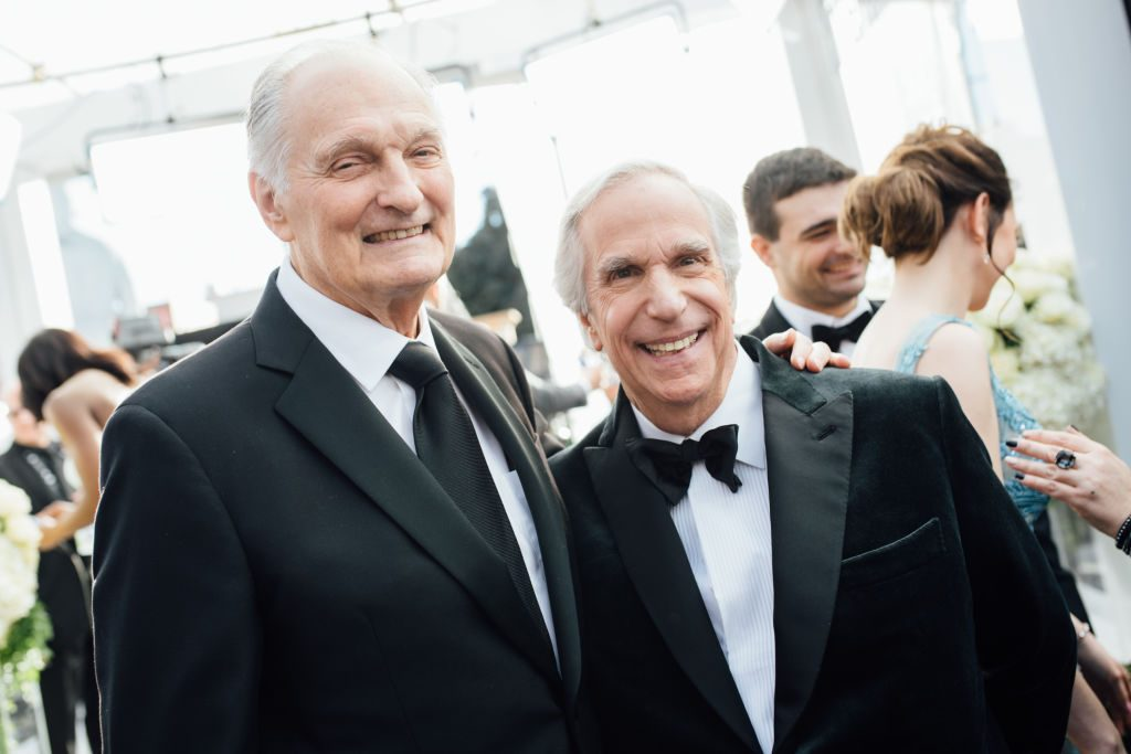 LOS ANGELES, CALIFORNIA - JANUARY 27:  (EDITORS NOTE: Image has been edited using a digital filter) Alan Alda (L) and Henry Winkler arrive at the 25th annual Screen Actors Guild Awards at The Shrine Auditorium on January 27, 2019 in Los Angeles, California. (Photo by Emma McIntyre/Getty Images for Turner)