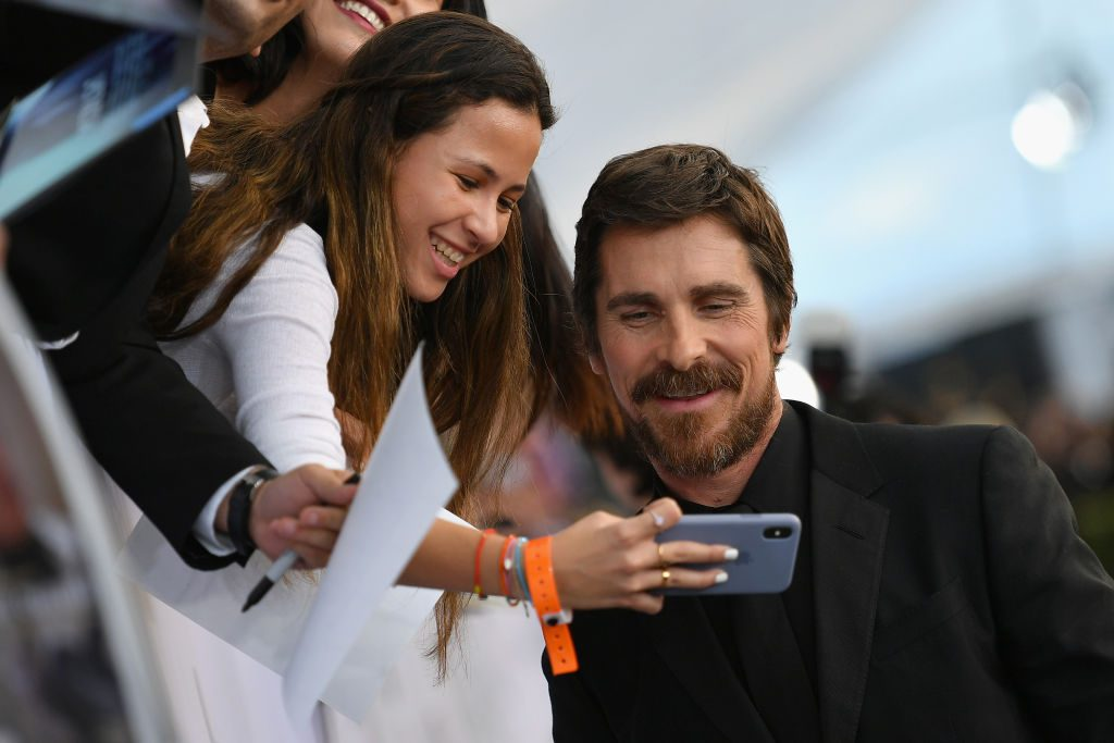 LOS ANGELES, CA - JANUARY 27:  Christian Bale poses with a fan at the 25th Annual Screen ActorsGuild Awards at The Shrine Auditorium on January 27, 2019 in Los Angeles, California. 480543  (Photo by Mike Coppola/Getty Images for Turner)
